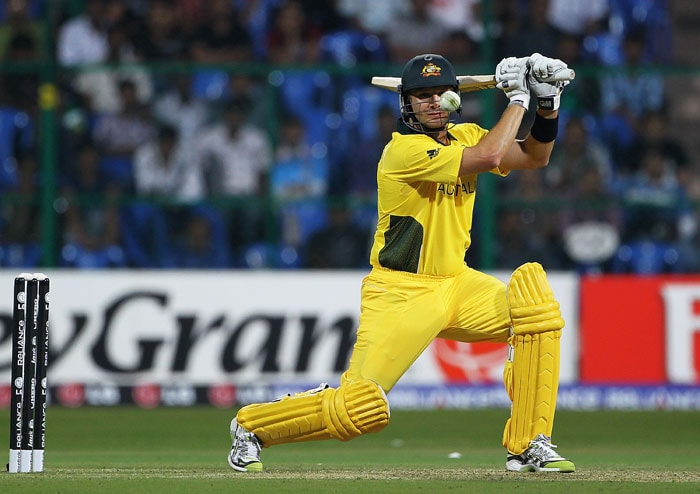 Shane Watson hits the ball towards the boundary during the 2011 ICC World Cup warm-up game between India and Australia at the M. Chinnaswamy Stadium in Bangalore. (Getty Images)