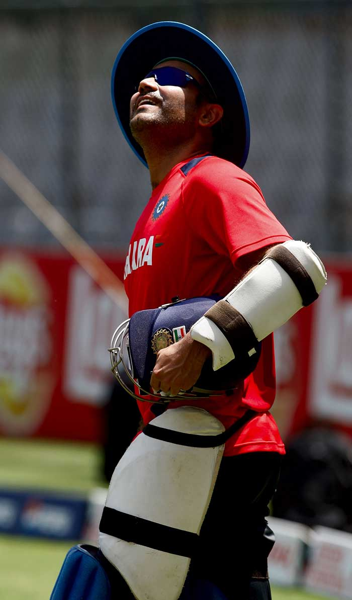 Virender Sehwag looks to the heavens during India's practice session. (Getty Images)