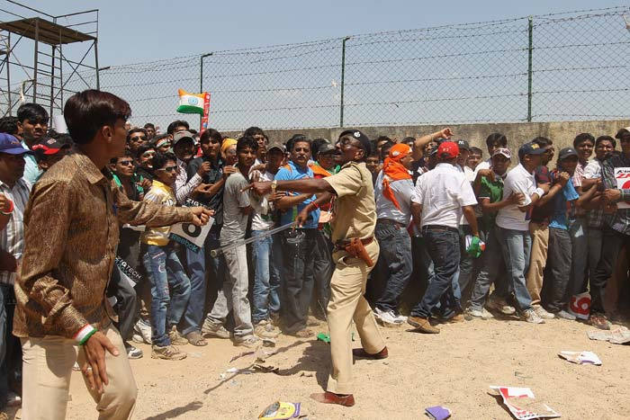 A policeman lathicharges fans queuing outside the stadium ahead of the 2011 ICC World Cup quarter final match between Australia and India at the Sardar Patel Stadium in Ahmedabad. (Getty Images)