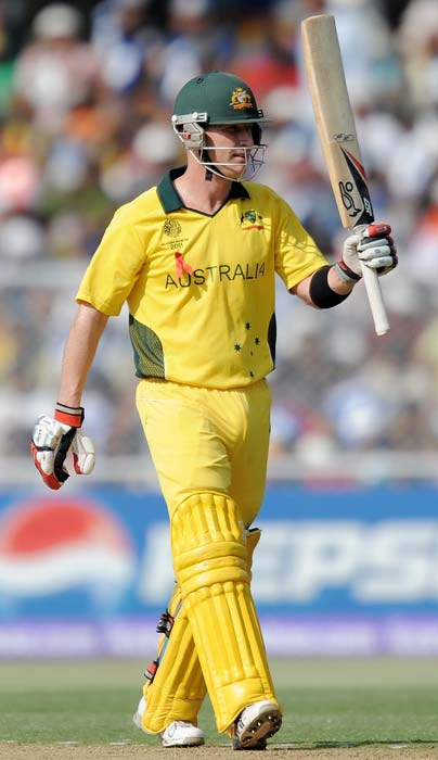 Brad Haddin raises his bat after scoring his half-century during the ICC World Cup quarter final match between Australia and India at the Sardar Patel Stadium in Ahmedabad. (AFP Photo)