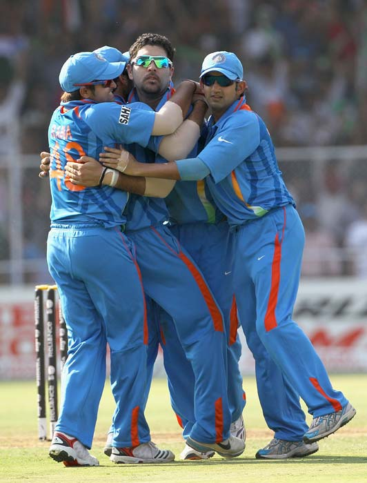 Yuvraj Singh is congratulated by teammates on the wicket of Michael Clarke during the 2011 ICC World Cup quarter final match between Australia and India at the Sardar Patel Stadium in Ahmedabad. (Getty Images)