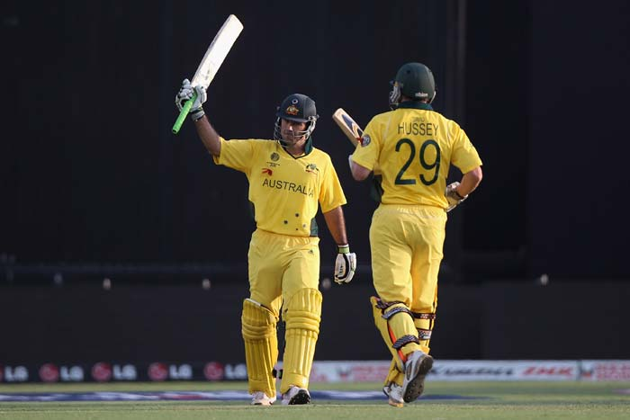 Ricky Ponting acknowledges the crowds applause after reaching his century as David Hussey offers his support during the 2011 ICC World Cup quarter final match between Australia and India at the Sardar Patel Stadium in Ahmedabad. (Getty Images)