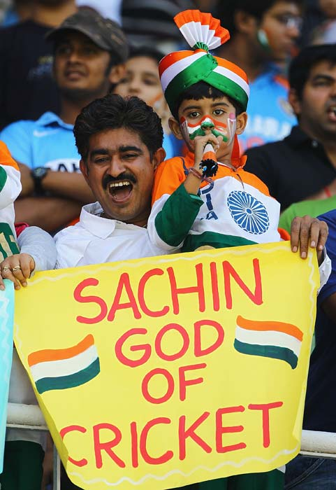 A young cricket fan shows his support to Sachin Tendulkar during the 2011 ICC World Cup quarter final match between Australia and India at Sardar Patel Stadium in Ahmedabad. (Getty Images)