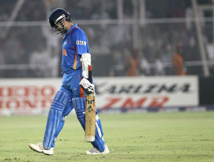 Sachin Tendulkar leaves the field after being dismissed during the 2011 ICC World Cup quarter final match between Australia and India at the Sardar Patel Stadium in Ahmedabad. (Getty Images)