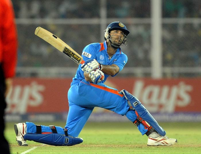 Yuvraj Singh plays a shot during the quarter final match of the ICC World Cup 2011 between India and Australia at the Sardar Patel Stadium in Motera in Ahmedabad. (AFP Photo)