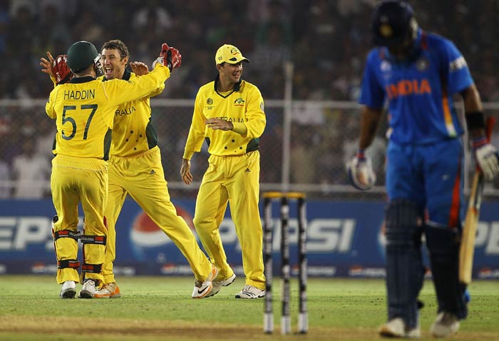 David Hussey celebrates the wicket of Virat Kohli after he was caught by Michael Clarke during the 2011 ICC World Cup quarter final match between Australia and India at the Sardar Patel Stadium in Ahmedabad. (Getty Images)