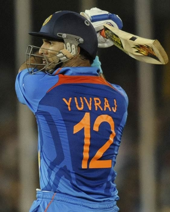 Yuvraj Singh plays a shot during the quarter final match of the ICC World Cup 2011 between India and Australia at the Sardar Patel Stadium in Ahmedabad. (AFP Photo)