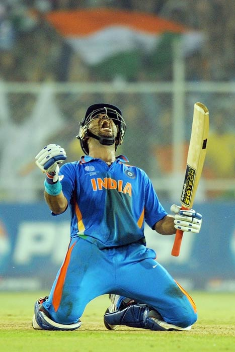 Yuvraj Singh celebrates after beating Australia in the quarter final match of the ICC World Cup 2011 at The Sardar Patel Stadium in Ahmedabad. (AFP Photo)
