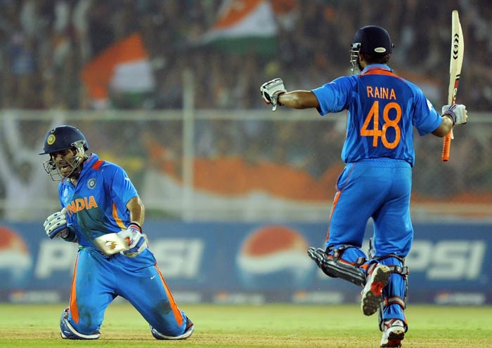 Yuvraj Singh and teammate Suresh Raina celebrate after beating Australia in the quarter final match of the ICC World Cup 2011 at the Sardar Patel Stadium in Ahmedabad. (AFP Photo)