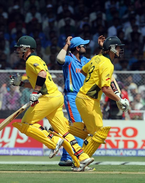 Shane Watson and Brad Haddin run between the wickets during the World Cup quarter final match between India and Australia at the Sardar Patel Stadium in Ahmedabad. (AFP Photo)
