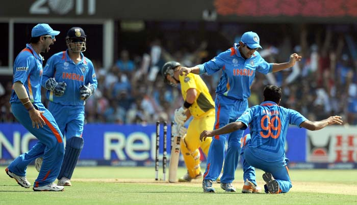 Yuvraj Singh, MS Dhoni, Ravichandran Ashwin and Suresh Raina celebrate as Shane Watson is bowled out during the quarter final match of the ICC World Cup 2011 between India and Australia at the Sardar Patel Stadium in Ahmedabad. (AFP Photo)