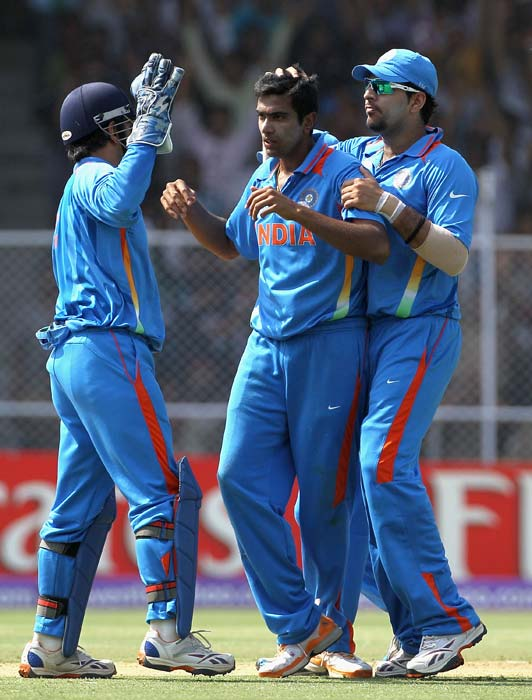 Ravichandran Ashwin is congratulated by teammates on the wicket of Shane Watson during the 2011 ICC World Cup quarter final between Australia and India at the Sardar Patel Stadium in Ahmedabad. (Getty Images)