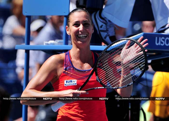 Italy's 83rd-ranked Flavia Pennetta advanced to her first Grand Slam semi-final by beating 10th-seeded compatriot Roberta Vinci 6-4, 6-1.