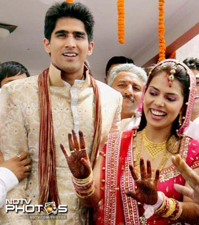 <b>Vijender Singh:</b> Known to pack a punch, Vijender powered his way into matrimony when he got married to Delhi girl Archana. The event was glamorous and was attended by Rahul Gandhi and other heavyweights from the political and sporting fraternity.