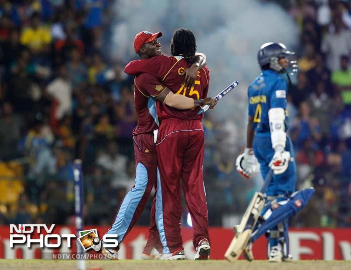 Chris Gayle and Darren Sammy embrace each other after the win.
