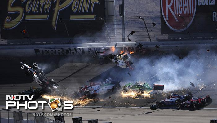 """Several cars were sent flying while others careered down the track in flames, littering the track with smoking debris.<br><br>""""IndyCar is very sad to announce that Dan Wheldon has passed away from unsurvivable injuries,"""" IndyCar chief executive Randy Bernard said."""