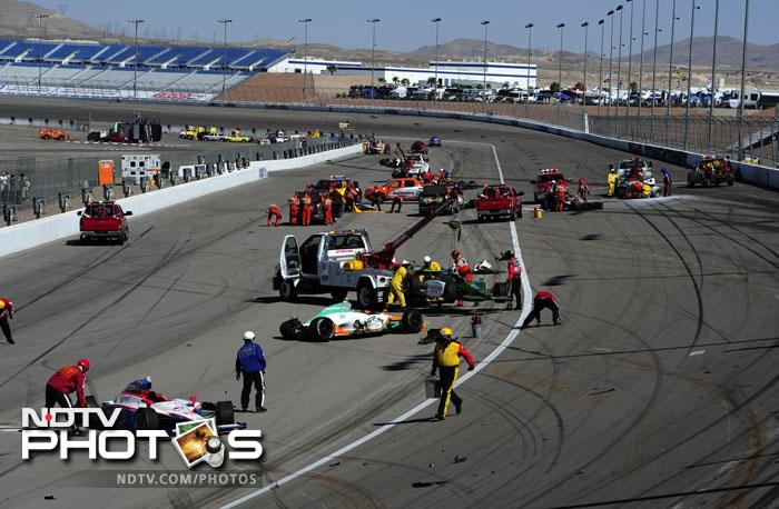 The crash started at Turn 2 of the 1.5-mile (2.4-kilometer) Las Vegas oval on the 12th lap of the race. The chain-reaction appeared to begin when Wade Cunningham's car swerved and J.R. Hildebrand drove over Cunningham's car. Hildebrand went airborne while Cunningham went into the wall.