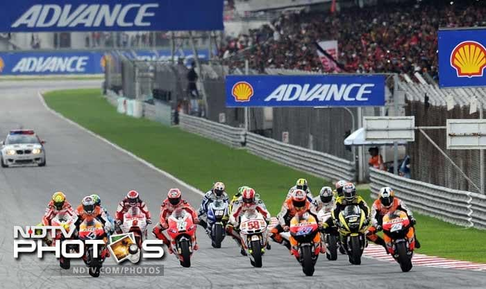 The race at the Sepang circuit was immediately red-flagged and organisers later announced it had been cancelled. Edwards also fell and suffered a separated shoulder, a race doctor said, while Rossi was able to return to the pits. The stunned other riders were not available for comment after the race.<br><br><b>Coming Up:</b> Crash that killed Dan Wheldon