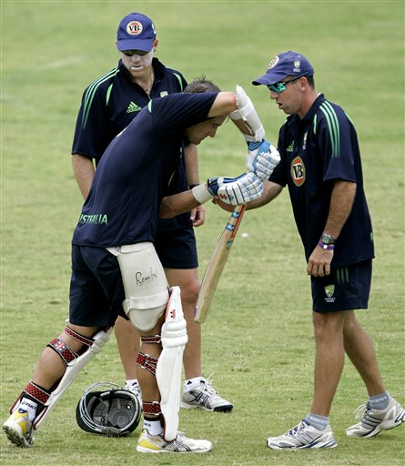 Australia's coach Tim Nielsen, right, revises opening batsman Phil Jaques' batting skills as performance analyst Richard McInnes, left, looks on during a training session at the Antigua Recreation Ground in St. John's on Wednesday, May 28, 2008. The second cricket Test match between West Indies and Australia begins on Friday.
