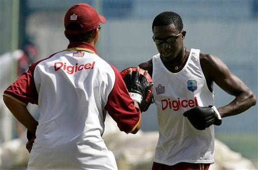 West Indies' Jerome Taylor, right, practices boxing exercises during a training session at the Antigua Recreation Ground in St. John's on Wednesday, May 28, 2008. The second cricket Test match between West Indies and Australia begins on Friday.