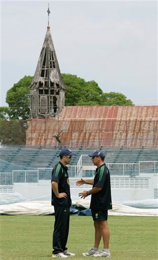 Australia's coach Tim Nielsen, right, speaks with opening batsman Simon Katich at the beginning of a training session at the Antigua Recreation Ground in St. John's on Wednesday, May 28, 2008. The second cricket Test match between West Indies and Australia begins on Friday.
