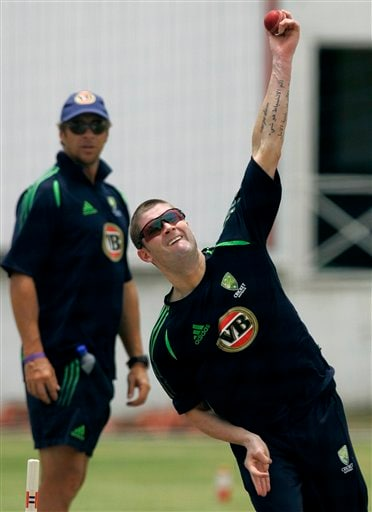 Australia's vice captain Michael Clarke bowls in the nets as bowling coach Troy Cooley, rear, looks on during a training session at the Antigua Recreation Ground in St. John's on Wednesday, May 28, 2008. The second cricket Test match between West Indies and Australia begins on Friday.