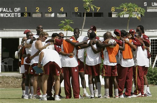 West Indies cricket players huddle at the beginning of a training session at the Antigua Recreation Ground in St. John's on Wednesday, May 28, 2008. The second cricket Test match between West Indies and Australia begins on Friday.