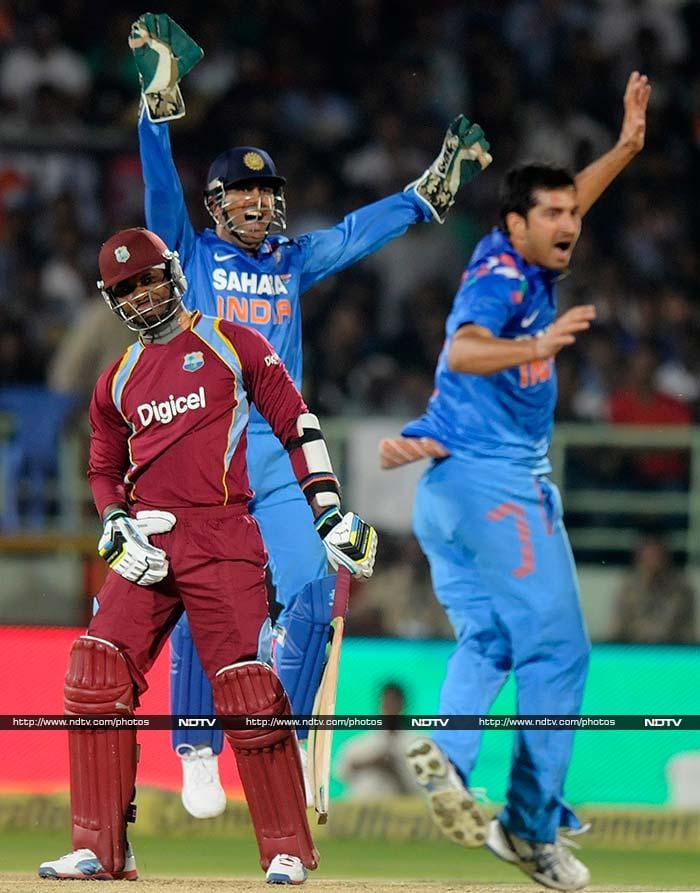 West Indies' reply was typically weak as the tourists lost two quick wickets. <br><br>While Johnson Charles (12) was claimed by Bhuvneshwar Kumar, Mohit Sharma (in pic) reduced WI to 23/2 in 5.4 when he dismissed Marlon Samuels (8).