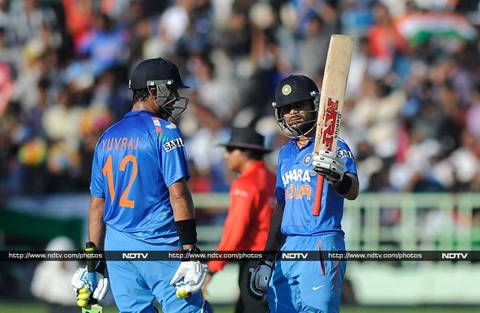 Kohli was joined by Yuvraj Singh (left) at the crease. <br><br>The Delhi batsman completed his fifty off 59 and raced his way to another 49 before falling a run short of the three-figure mark.