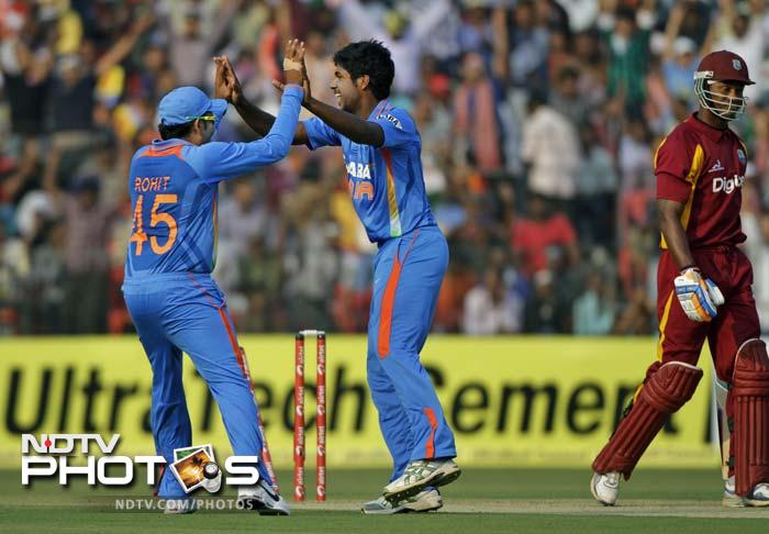 The young Indian pace attack of Vinay Kumar, Varun Aaron (in pic, center) and Umesh Yadav was quite impressive, taking 5 wickets between them and also keeping the Windies' run-rate in check.