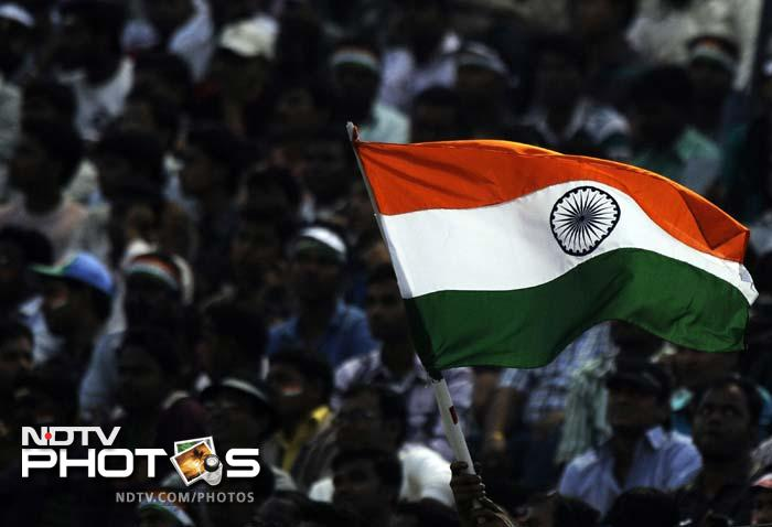 Play was briefly stopped during India's innings when a few frustrated fans in the jampacked crowd vented their ire at West Indies fielder Kieron Pollard by throwing missiles.