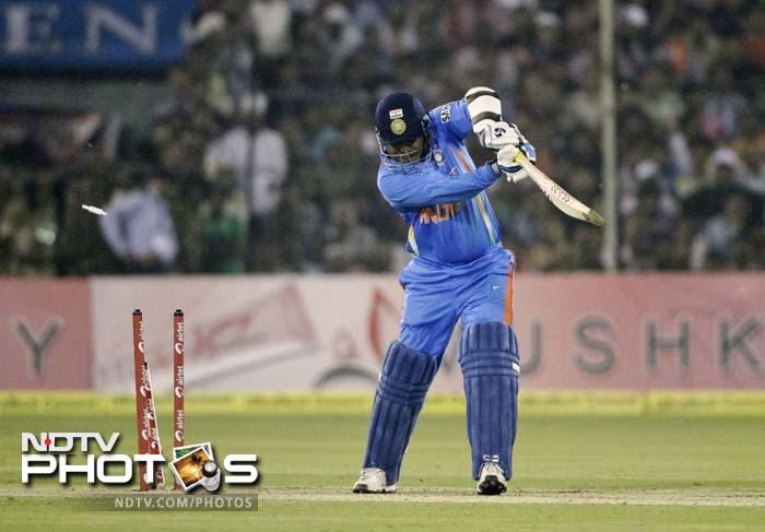 Skipper Virender Sehwag departed after attempting a loose drive off Andre Russell.