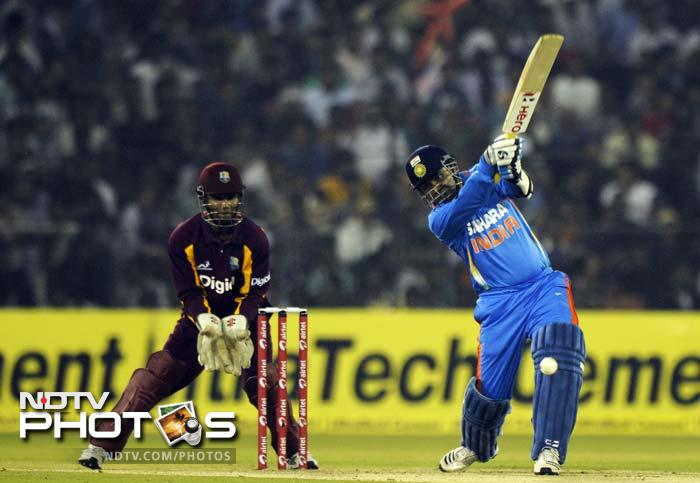 Chasing 212, India had begun well briefly with Virender Sehwag taking charge.