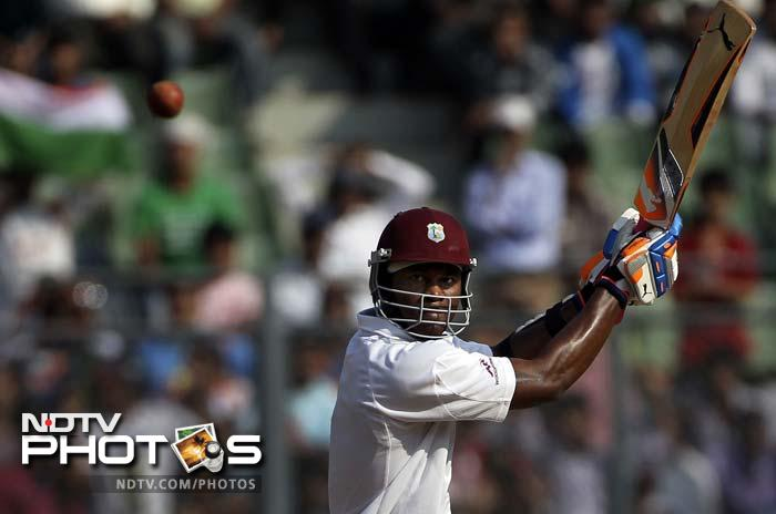 Marlon Samuels fell 4 overs before the close of play but not before completing his 13th Test fifty.