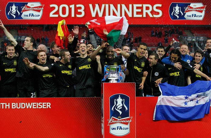 It took a solitary injury-time goal to let the 'under-dogs' beat the giants and claim the FA Cup title. It was indeed a magical moment for Wigan Athletic at the Wembley, one which their fans would cherish for a long time to come. (AFP images)