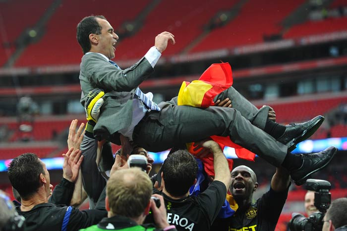 Over at the other end though, it was jubilation. Manager Roberto Martinez is hurled up by his team after the match.