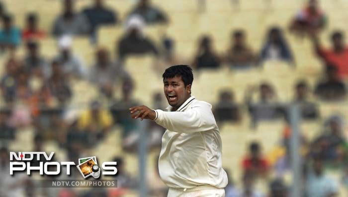 In the first innings, Pragyan Ojha carried on his good form from the first Test to pick up four wickets.