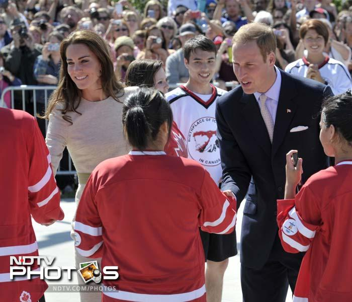 The mood though, reportedly, could not be kept away from sports for too long as they greet young hockey players in this photograph.