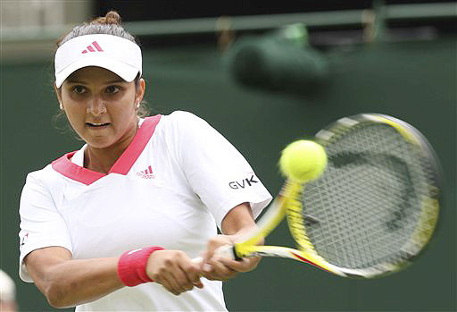 Sania Mirza of India returns to Anna-Lena Groenefeld of Germany during their Ladies Singles first round match at Wimbledon on June 22, 2009. (AP Photo)