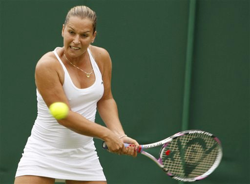 Dominika Cibulkova of Slovakia returns to Julie Coin of France during their Ladies Singles first round match at Wimbledon. (AP Photo)