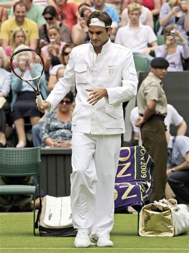 Roger Federer of Switzerland arrives for his first round match against Lu Yen-Hsu of Chinese Taipei on centre court at Wimbledon. (AP Photo)