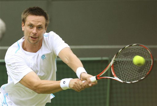 Sweden's Robin Soderling returns to Gilles Muller of Luxembourg during their Gentlemen's Singles first round match at Wimbledon. (AP Photo)