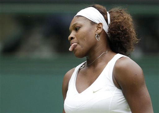 Serena Williams of USA reacts while playing Neuza Silva of Portugal during their first round match on centre court at Wimbledon. (AP Photo)