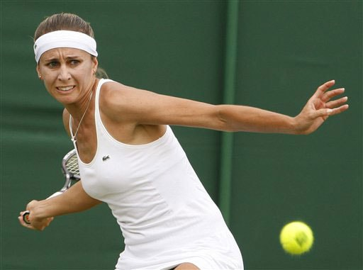 Gisela Dulko of Argentina returns to Stephanie Foretz of France during their Ladies Singles first round match at Wimbledon. (AP Photo)