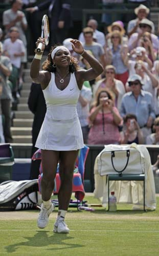 US' Serena Williams acknowledge the crowd after defeating Russia's Elena Dementieva during their semi-final match on centre court at Wimbledon. (AP Photo)