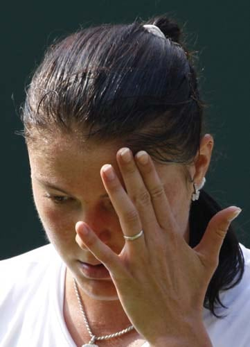 Russia's Dinara Safina wipes her face, during her women's singles semi-final against US' Venus Williams on the Centre Court at Wimbledon. (AP Photo)