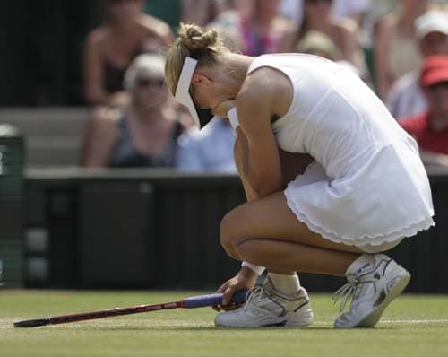 Russia's Elena Dementieva reacts while playing US' Serena Williams during their semi-final match on centre court at Wimbledon. (AP Photo)