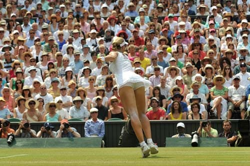 Russia's Elena Dementieva returns a ball to US' Serena Williams during their semi-final match on centre court at Wimbledon. (AFP Photo)
