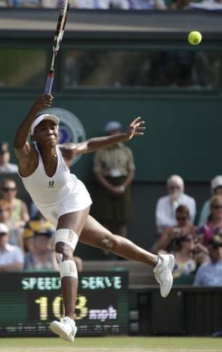 US' Venus Williamsreturns to Russia's Dinara Safina during their semi-final match on centre court at Wimbledon. (AP Photo)