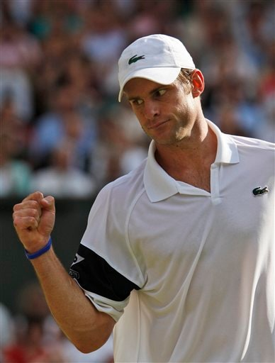 Andy Roddick of US reacts to a point won against Andy Murray of Britain during their semi-final match on centre court at Wimbledon on Friday, July 3, 2009. (AP Photo)